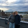 ON THE ROOFTOP OF AMY AND J.P'S CONDO HAVING A DRINK. HUDSON RIVER BEHIND US