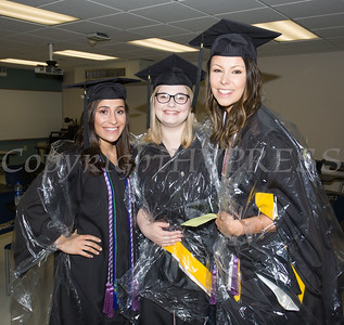 Nursing students Gina Zinzi, Kayla Winne and Megan Williams put on rain ponchos, prior to Mount Saint Mary College's 55th Commencement Exercises for the graduating Class of 2018 in Newburgh, NY on Saturday, May 19, 2018. Hudson Valley Press/CHUCK STEWART, JR.