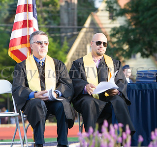 Newburgh Free Academy North Campus Co-Principal Matteo Doddo and Superintendent of School Dr. Roberto Padilla listen to speakers during the 153rd Commencement Exercises for the graduating Class of 2018 on Academy Field in the City of Newburgh, NY on Thursday, June 21, 2018. Hudson Valley Press/CHUCK STEWART, JR.