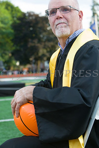 Newburgh Free Academy teacher Mr. Mills grabs a beach ball from students during the 153rd Commencement Exercises for the graduating Class of 2018 on Academy Field in the City of Newburgh, NY on Thursday, June 21, 2018. Hudson Valley Press/CHUCK STEWART, JR.