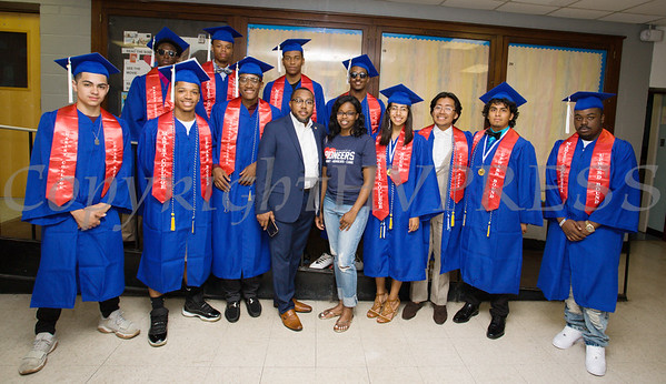 Mebers of the Poughkeepsie High School Class of 2018 that participated in the Marist College Upward Bound program pose with their mentor Ralph Coates on Friday, June 26, 2018 in Poughkeepsie, NY. Hudson Valley Press/CHUCK STEWART, JR.