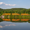 NECR train 611 relects in a backwater of the Connecticut RIver arriving in Brattleboro, Vermont.