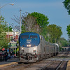 Amtrak Downeaster train 687 passes through West Medford on a Friday evening in May.