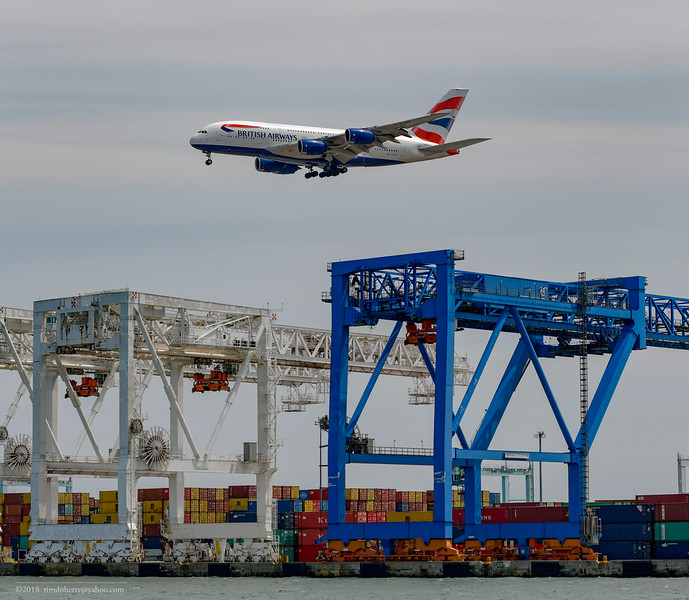 British Airways Flight 213 flys over the the cranes at Conley Terminal in South Boston.