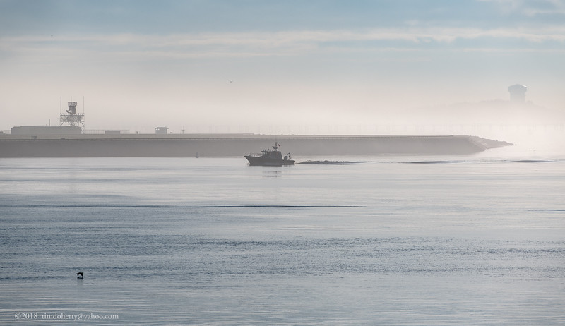 The Boston Pilot Boat Chelsea passing Logan Airport in the clearing fog.