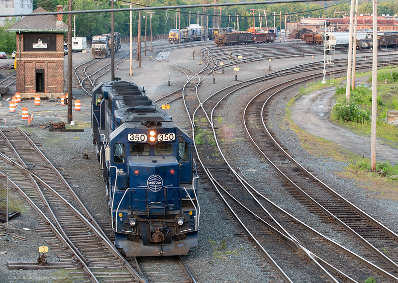 The locomotives from PLED head to the house tracks at East Deerfield. The Plainville, CT to East Deerfield train had made rare daylight run up the Conn River on Friday June 8, 2018.