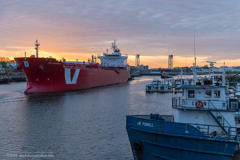 The tanker Iver Properity heads out from Chelsea Chreek at sunrise.