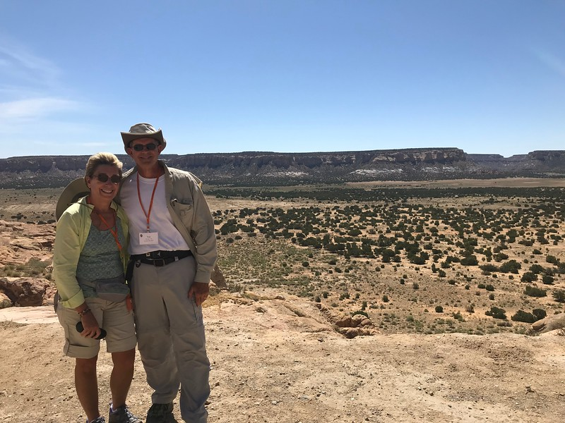 Mary and Ted with the view from Acoma - Bridget St. Clair