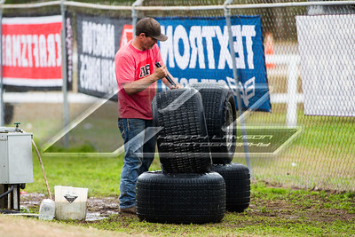 Crew member cleaning tires