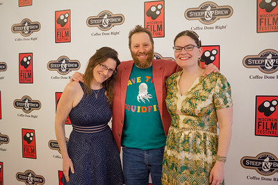 John May (center - director, THE LAST SQUIDFISH) and friends celebrate the opening of the 2018 Wisconsin Film Festival.