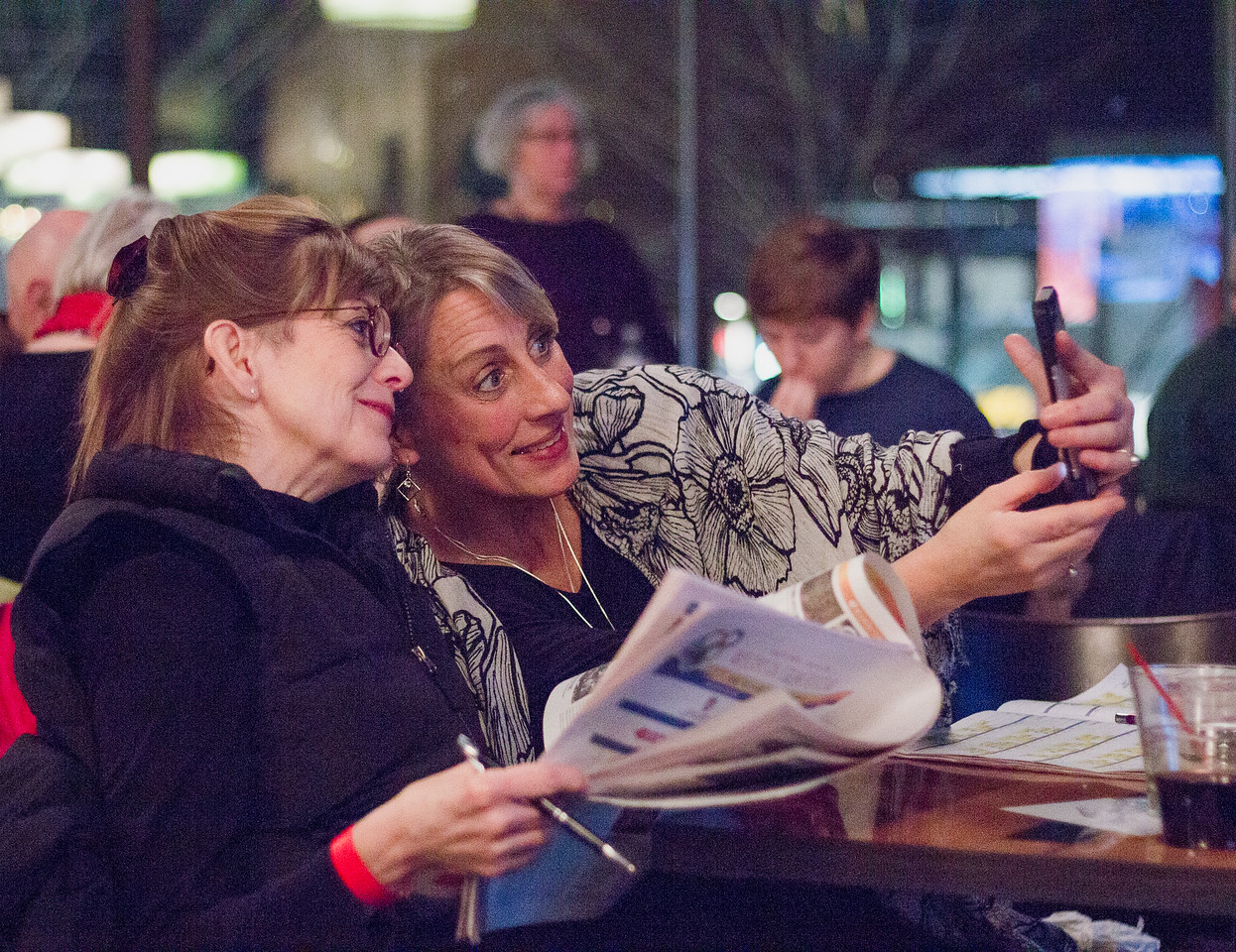 Patron Jane Schroeder (right) and friend take selfies during the 2018 First Look at the Fest.