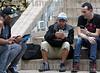Cuba : Varias personas se conectan a la internet con su celular en una calle de La Habana , Cuba en una zona de conexión Wifii / Several people connect to the Internet with their cell phone in a Havana street / Kuba : Männer benutzen ihr Mobiltelefon © Ernesto Mastrascusa/LATINPHOTO.org
