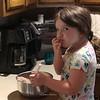 Taste-testing the brownie mix.  7/6/18