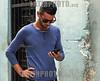 Cuba : Un Jóven se conectan a la internet con su celular en una calle de La Habana , Cuba en una zona de conexión Wifii / A young man connects to the internet with his cell phone on a street in Havana , Cuba in a Wifii connection zone.  / Kuba : Ein Jugendlicher benutz sein Mobiltelefon © Ernesto Mastrascusa/LATINPHOTO.org