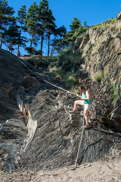 Emily scaling down the rope to the secret beach on Gaff Head.  Sister Fiona afraid at the top.