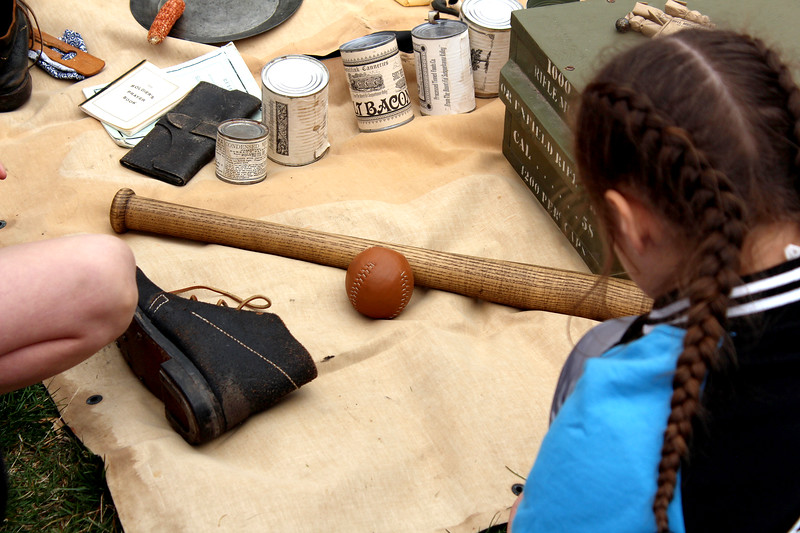 A rounders bat and ball were included with the assortment of items that a soldier in the Civil War would have carried with him, as shown at the 10th Illinois Infantry Re-enactment Group's living history encampment at Knights Park in Sandwich on Friday. Rounders was a game with elements similar to softball, baseball and cricket.