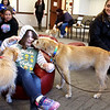 Rosalie Wix (center), 4, got kisses from Missy (left) and Reba (right) during a meet-and-greet event for the Fox Valley Therapy Dog Club at the Sandwich Public Library on April 17. Many of the children who came to the event had heard about it at school, after club members paid a visit to Lynn G. Haskin Elementary School.