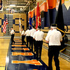 The Yorkville American Legion Post 489 Honor Guard brings the colors out onto the floor of the Oswego High School gymnasium to open the school's Wall of Honor induction ceremony on Monday.