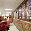 Carol Murphy snaps a photo of two of her sons who are featured on the Wall of Honor at Oswego High School following the 2018 induction ceremony Monday evening. Keegan and Rourke Murphy, her two younger sons, will enter the armed forces after graduating from OHS in May.
