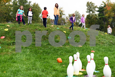 Children bowl with pumpkins during the Northeast Elementary's annual Fall Festival Thursday morning.