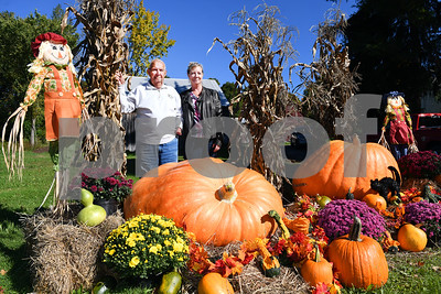 Leonard Lussier, left stands next to his daughter Lisa Gates outsider her home in Benson in front of one 821 pound pumpkin, left, and a 600 pound pumpkin on the right. The pumpkins will be on the route for the annual Benson Haunted Hay Ride which takes place Saturday night at 7pm.