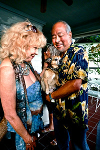 Cheryl Haley with friendly dog and Chris Wong - Party of George Von Bozzay and Cheryl Haley at home in Belvedere, California