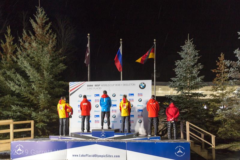 Men's medal podium: flag raising