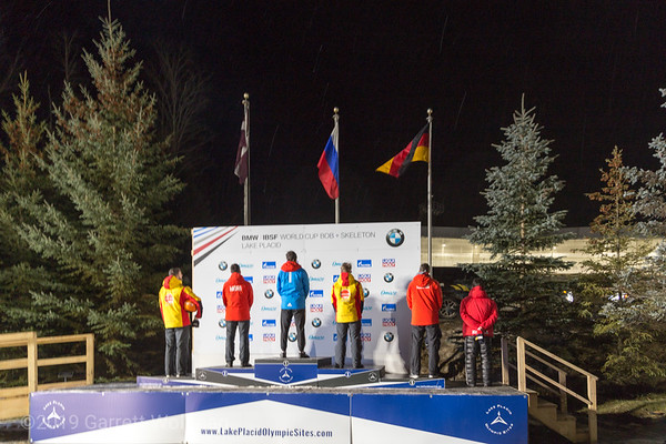 Men's medal podium: flag raising