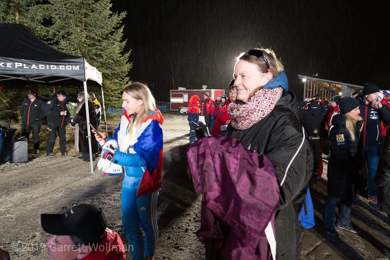 Nikitina photographing the men's podium