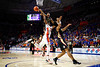 Florida State Seminoles guard Devin Vassell (24) blocks a shot attempt from Florida Gators forward Omar Payne (5) during the second half as the #6 Florida Gators mens basketball team hosted the Florida State Seminoles at Exacteh Arena in Gainesville, Florida.  November 10th, 2019. Gator Country Photo by David Bowie.
