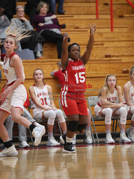 Thrashers Jaliya White (15) takes a shot against New Site in Tuesdays Prentiss Co Shootout