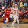 Thrashers Christi Lazones (12) looks to gain possession of the ball against New Site's Gracie Yates (10) in Tuesdays Prentiss Co Shootout at New Site