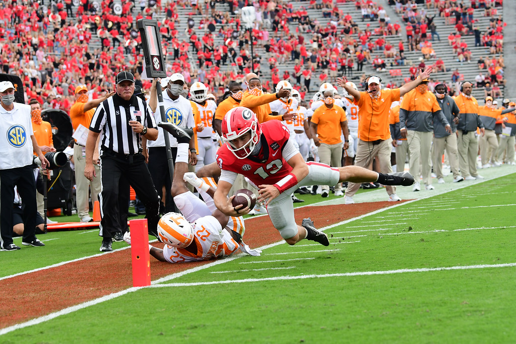 Georgia quarterback Stetson Bennett (13)] stretches for the pylon during the Bulldogs' game with Tennessee in Athens, Ga., on Saturday, Oct. 10, 2020.. (Photo by Perry McIntyre)