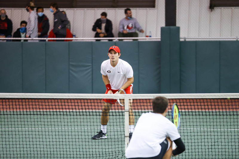 Georgia tennis player Billy Rowe during a match against NC State at the Lindsey Hopkins Indoor Center on Jan. 31, 2021, in Athens, Georgia. (Photo by Chamberlain Smith)