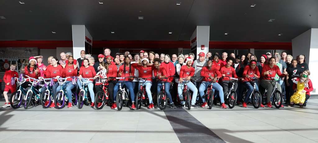"""The Georgia women's basketball team met with the Fastbreak Club in Stegeman Coliseum for their annual """"Bike Build"""" on Saturday, Dec. 14, 2019. (Photo by Tony Walsh)"""