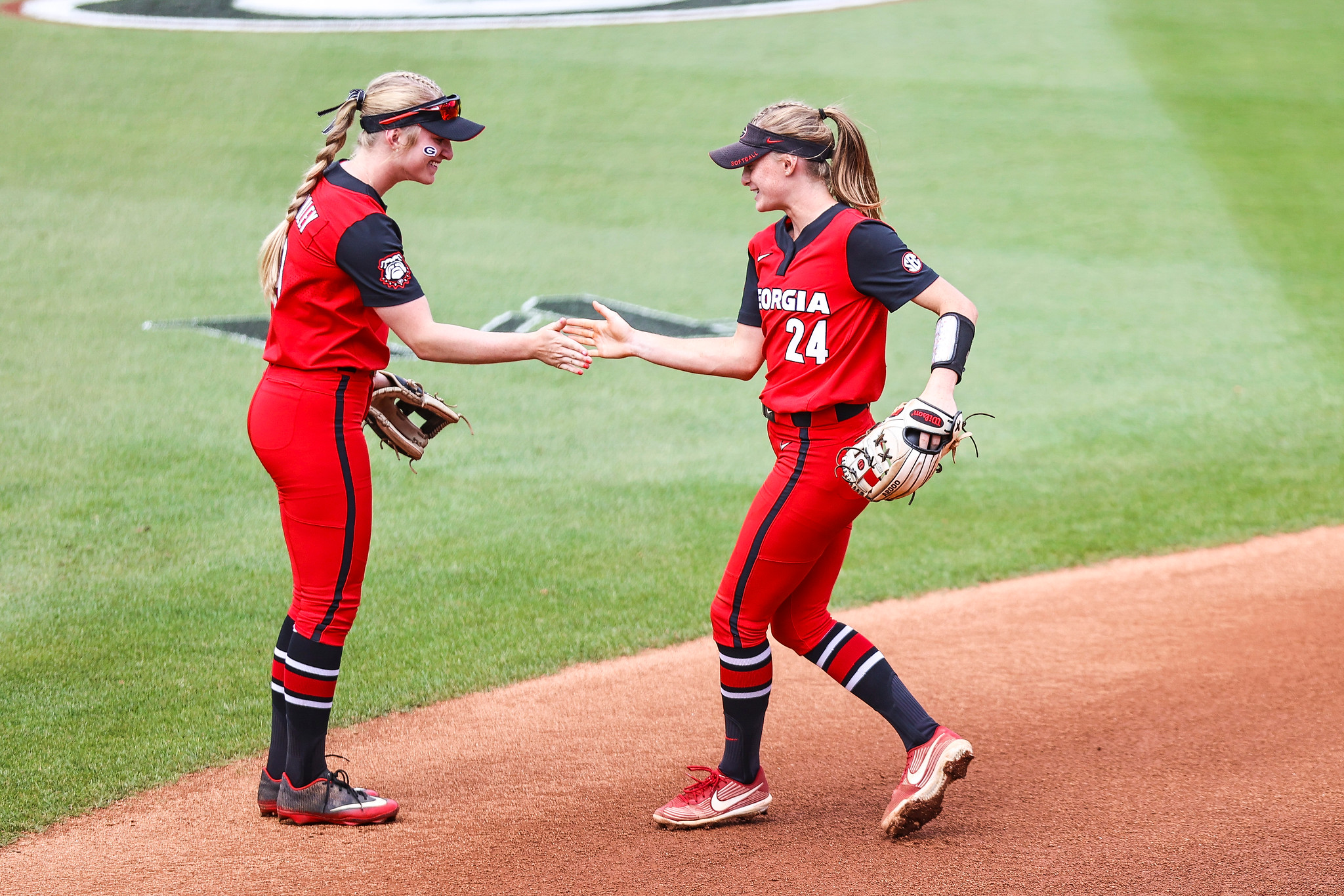 Georgia outfielder Sydney Chambley (9), Georgia infielder Ellie Armistead (24) during a game against Alabama at Jack Turner softball stadium in Athens, Ga., on Sunday, May 2, 2021. (Photo by Tony Walsh)