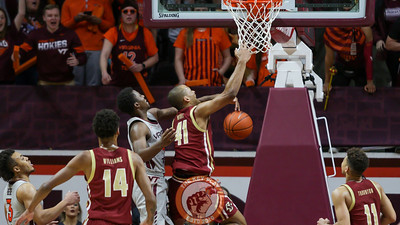 Boston College's Steffon Mitchell is fouled by Nahiem Alleyne in overtime as BC pulls away from Tech to win. (Mark Umansky/TheKeyPlay.com)