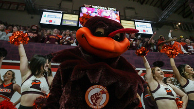 The Hokiebird jumps to Enter Sandman before the opening tip. (Mark Umansky/TheKeyPlay.com)