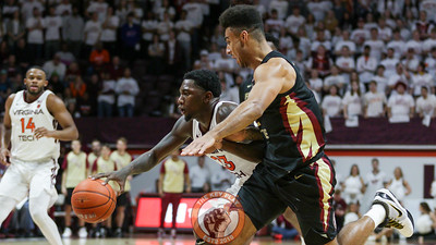 Tyrece Radford attempts to dribble the ball through the Florida State defense late in the game. (Mark Umansky/TheKeyPlay.com)