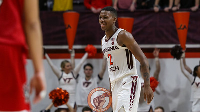 Landers Nolley smiles as the Hokies pull away from the Wolfpack late in the second half. (Mark Umansky/TheKeyPlay.com)