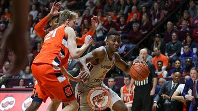 Landers Nolley tries to dribble around a pair of Syracuse defenders. (Mark Umansky/TheKeyPlay.com)