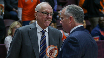 Syracuse head coach Jim Boeheim speaks with Virginia Tech head coach Mike Young before the game. (Mark Umansky/TheKeyPlay.com)