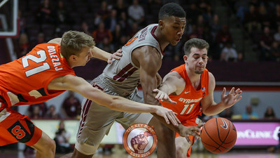 Landers Nolley is fouled by two Syracuse defenders in the first half. (Mark Umansky/TheKeyPlay.com)