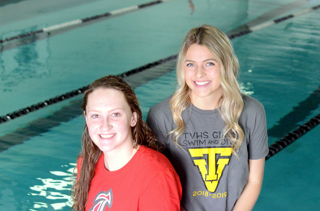 . The 2019 All-Area girls swimming & diving team is headlined by swimmer of the year Erin Lang of Loveland (left) and diver of the year Ryley Williams of Thompson Valley. (Mike Brohard/Loveland Reporter-Herald)