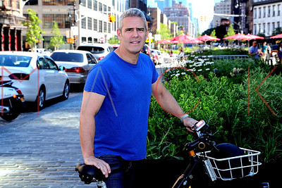 New York, NY - July 01:  Talk-show host Andy Cohen takes a spin with BUZZ E-Bikes, New York, USA.