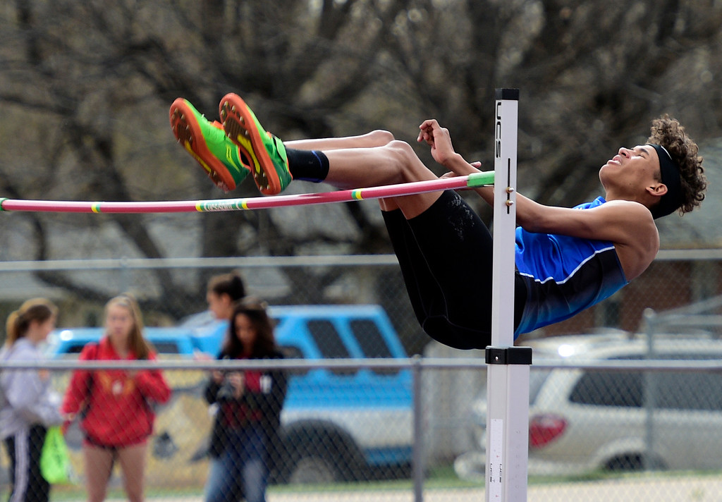 . LONGMONT, CO - April 20, 2019: Jonjak-Plahn, Colton, of Lyons, in the high jump at the Boulder County Track and Field Championships in Longmont. (Photo by Cliff Grassmick/Staff Photographer)