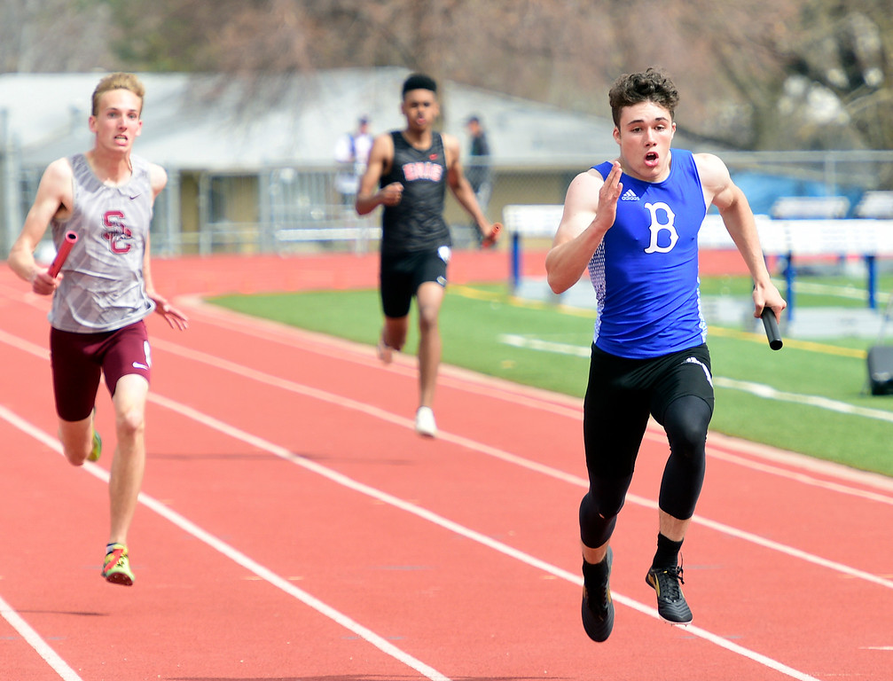 . LONGMONT, CO - April 20, 2019: Henry Desmarais, right, of Broomfield, finishes the 4X200 meter relay at the Boulder County Track and Field Championships in Longmont. (Photo by Cliff Grassmick/Staff Photographer)