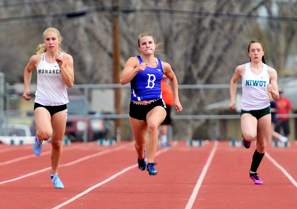 . LONGMONT, CO - April 20, 2019: Sydney Holiday, center, of Broomfield, wins the 100 meters  at the Boulder County Track and Field Championships in Longmont. (Photo by Cliff Grassmick/Staff Photographer)