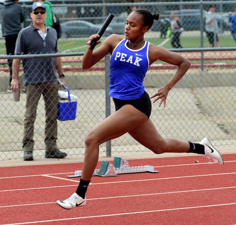 . LONGMONT, CO - April 20, 2019: Makenna Turner, of Peak to Peak, in the 4X200 meter relay  at the Boulder County Track and Field Championships in Longmont. (Photo by Cliff Grassmick/Staff Photographer)