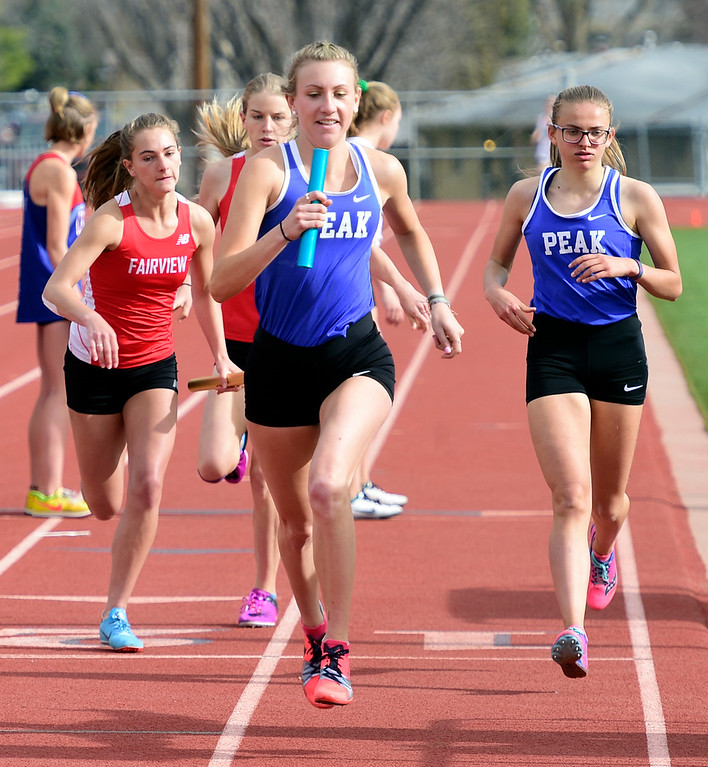 . LONGMONT, CO - April 20, 2019:  Quinn McConnell, center,  of Peak to Peak, in the 4X800 relay at the Boulder County Track and Field Championships in Longmont. (Photo by Cliff Grassmick/Staff Photographer)